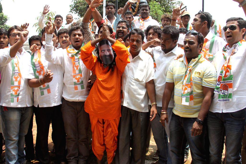 Bangalore Youth Congress members demonstrate against Yoga guru Ramdev for his remarks on Congress vice-president Rahul Gandhi, in Bangalore on April 29, 2014. - Rahul Gandhi