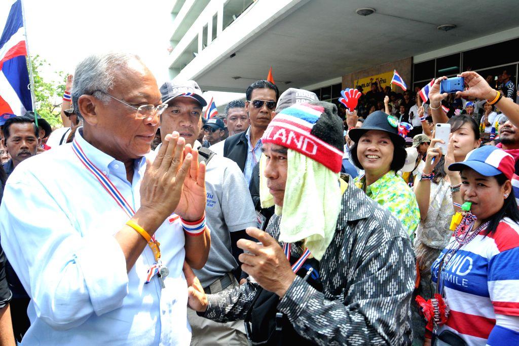 Anti-government protest leader Suthep Thaugsuban (L) reacts among Government Pharmaceutical Organization (GPO) officials during an anti-government protest in ...