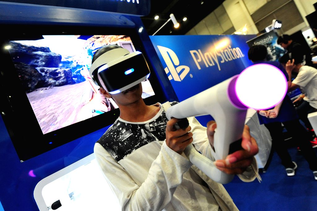 BANGKOK, April 21, 2017 - A visitor tries on a virtual reality (VR) gaming device during Thailand Comic Con 2017 in Bangkok, Thailand, April 21, 2017. Thailand Comic Con 2017, a three-day event that ...