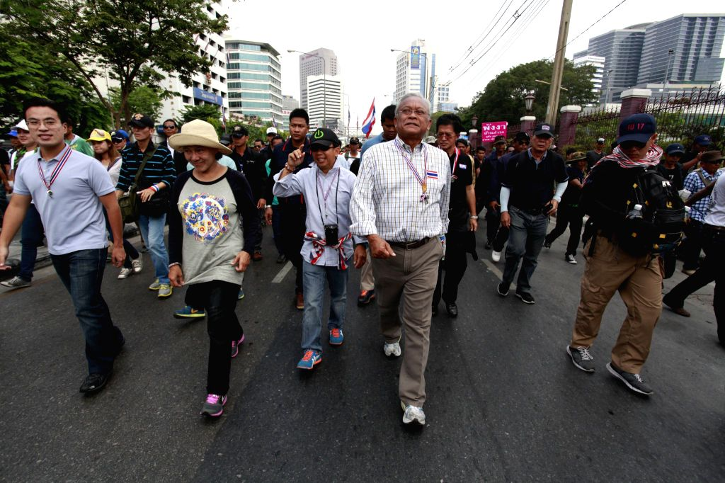 Anti-government protest leader Suthep Thaugsuban (4th L front) walks on street during an anti-government protest in Bangkok, Thailand, April 23, 2014. ...