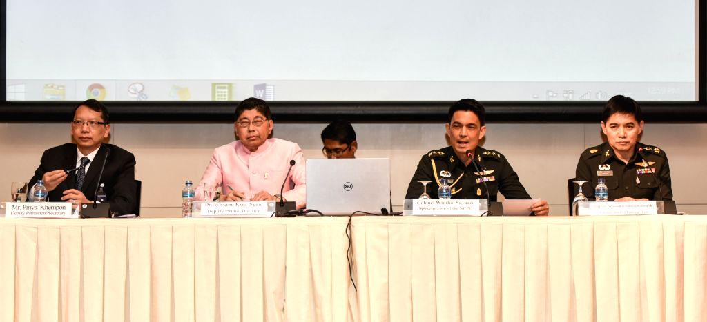 Wissanu Krea-Ngam (2nd L), deputy prime minister of Thailand, and Colonel Winthai Suvaree (2nd R), spokesman of the National Council for Peace and Order, attend a ...