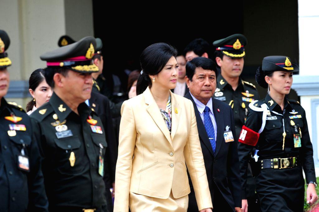 Thai Prime Minister Yingluck Shinawatra (3rd L) visits the Royal Thai Army Headquarters in Bangkok, Thailand, Aug. 16, 2013. (Xinhua/Rachen Sageamsak) ...