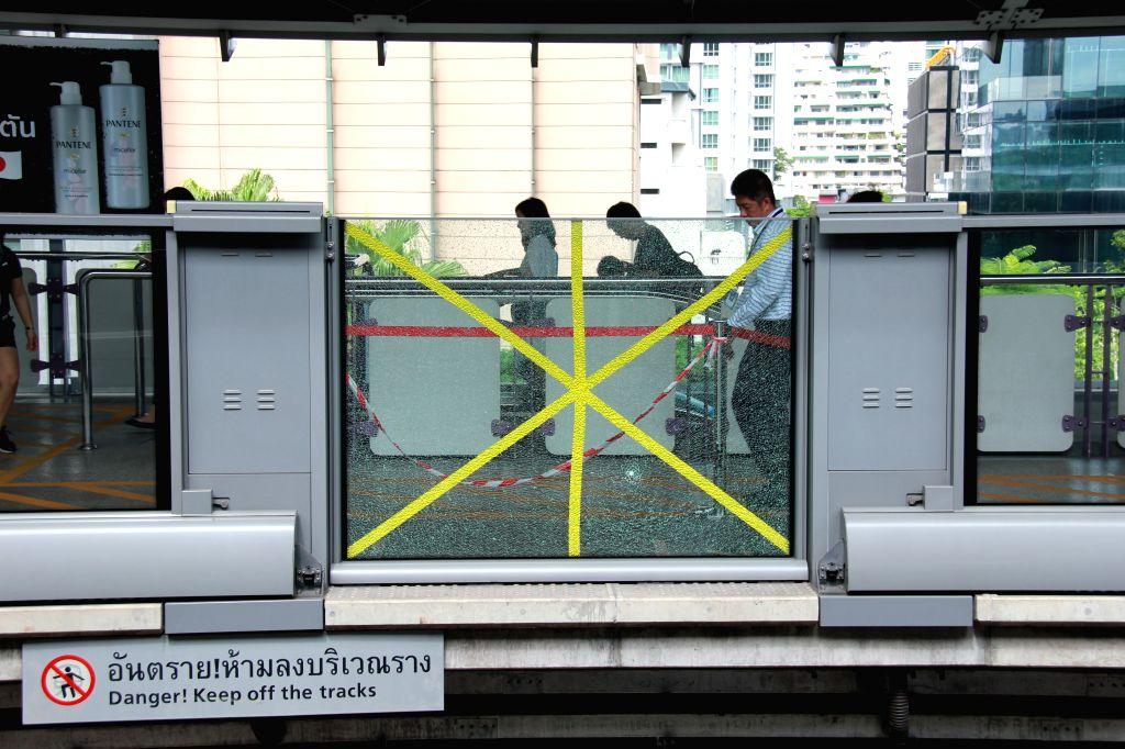 BANGKOK, Aug. 2, 2019 - Photo taken on Aug. 2, 2019 shows a platform screen door cracked after an explosion happened near BTS Chong Nonsi station downtown Bangkok, Thailand. A loud bang was heard ...