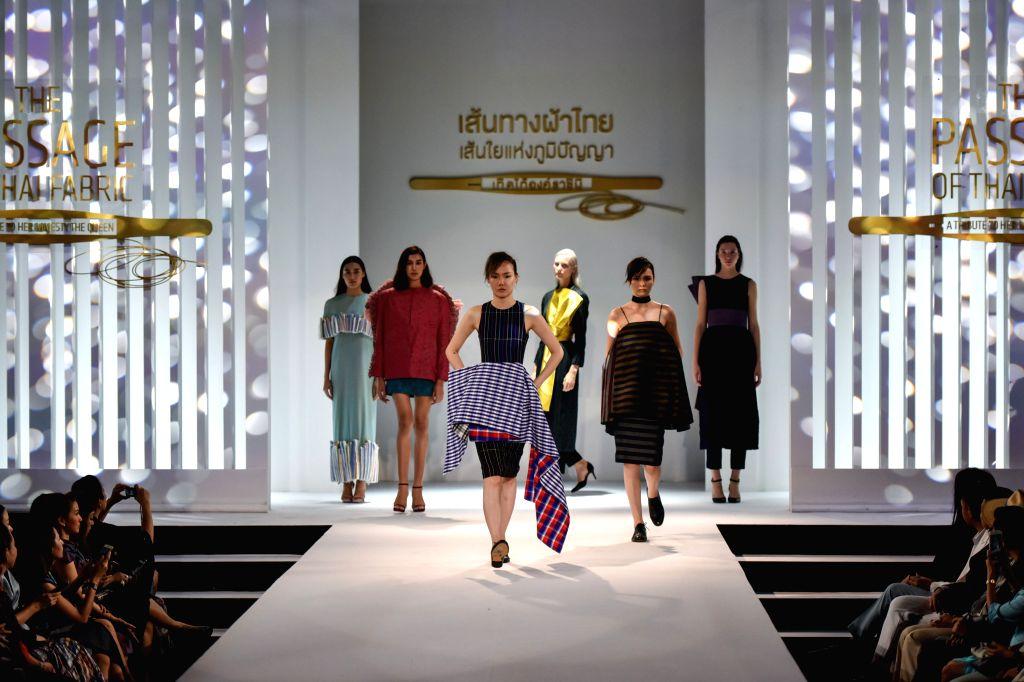 BANGKOK, Aug. 21, 2016 - Models present Thai fabric creations during a fashion show in Bangkok, Thailand, Aug. 20, 2016. Fashion designs representing styles of 15 Thai fabric producing areas were put ...