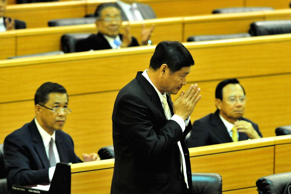 Phirasak Porjit (Front), vice-president of Parliament, greets members of National Legislative Assembly (NLA) at Parliament House in Bangkok, Thailand, Aug. 8, 2014. .