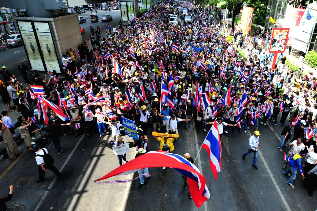 Thai anti-government protesters march across streets intending to push for Thailand's Prime Minister Yingluck Shinawatra's resignation ahead of a ... - Yingluck Shinawatras
