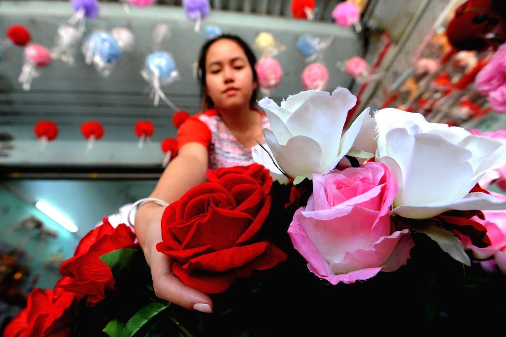 BANGKOK, Feb. 13, 2018 - A vendor prepares artificial flowers for the Valentine's Day at a flower shop in Bangkok, Thailand, Feb. 13, 2018.