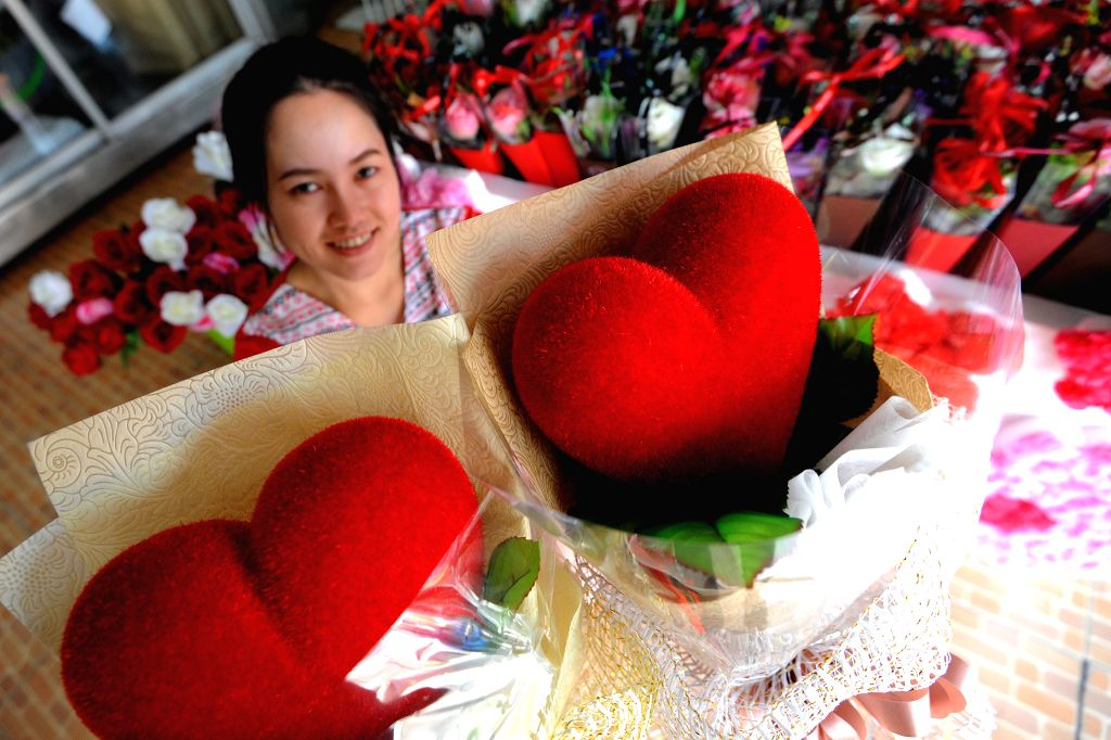 BANGKOK, Feb. 13, 2018 - A vendor prepares gifts and flowers for the Valentine's Day at a flower shop in Bangkok, Thailand, Feb. 13, 2018.
