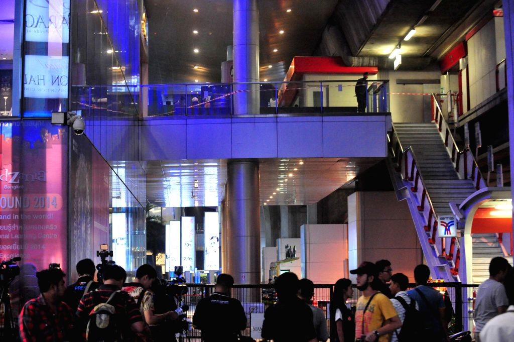 Thai soldiers stand guard in front of Siam Paragon shopping centre near the Siam Square station in Bangkok, Thailand, Feb. 1, 2015. Two explosions rocked Siam ...