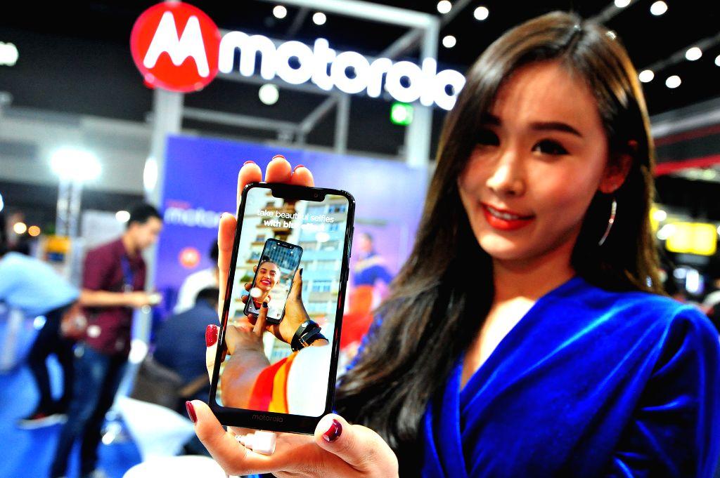 BANGKOK, Feb. 7, 2019 - A model presents a Motorola cellphone at the Thailand Mobile Expo 2019 in BITEC Bangna Exhibition in Bangkok, Thailand, Feb. 7, 2019.