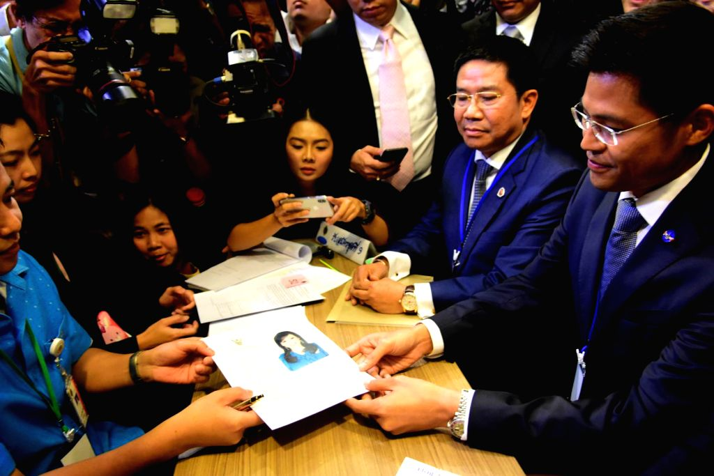 BANGKOK, Feb. 8, 2019 - Thai Raksa Chart party leader Preechapol Pongpanich (R) holds the registration document of Princess Ubolratana Mahidol in Bangkok, Thailand, Feb. 8, 2019. Thai Raksa Chart ...