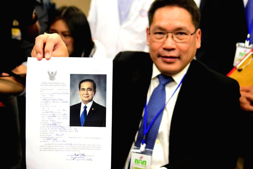 BANGKOK, Feb. 8, 2019 - The Palang Pracharath Party leader Uttama Savanayana holds the registration document of Thai Prime Minister Prayut Chan-o-cha in Bangkok, Thailand, Feb. 8, 2019. Thai Prime ... - Prayut Chan
