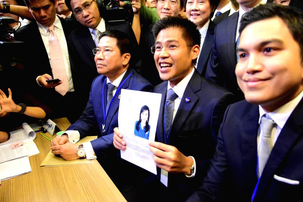 BANGKOK, Feb. 8, 2019 (Xinhua) -- Thai Raksa Chart party leader Preechapol Pongpanich (C) holds the registration document of Princess Ubolratana Mahidol in Bangkok, Thailand, Feb. 8, 2019. Thai Raksa Chart party on Friday nominated Princess Ubolratan