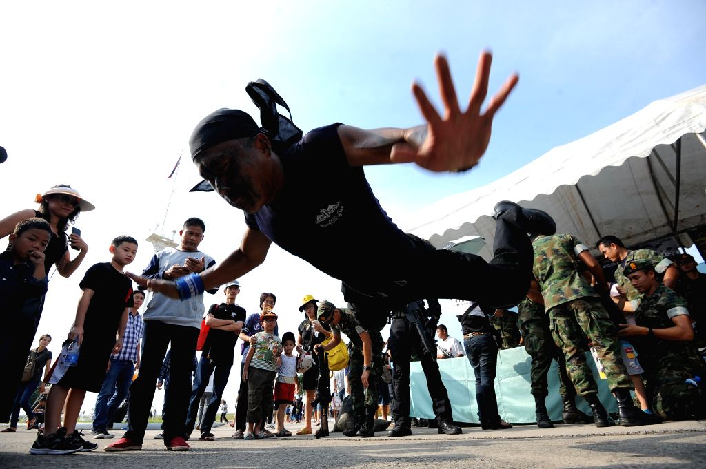 BANGKOK, Jan. 14, 2017 - Children and their parents watch a military stunt show during a Children's Day public-opening event at the Royal Thai Naval Academy in Bangkok, Thailand, Jan. 14, 2017. The ...