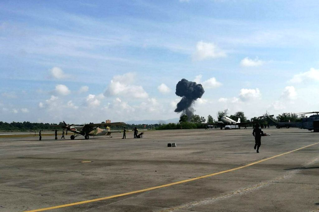 BANGKOK, Jan. 14, 2017 - This cellphone photo taken on Jan. 14, 2017 shows smokes rising from the crash site of a fighter jet during an air show to mark the National Children's Day at Hat Yai ...