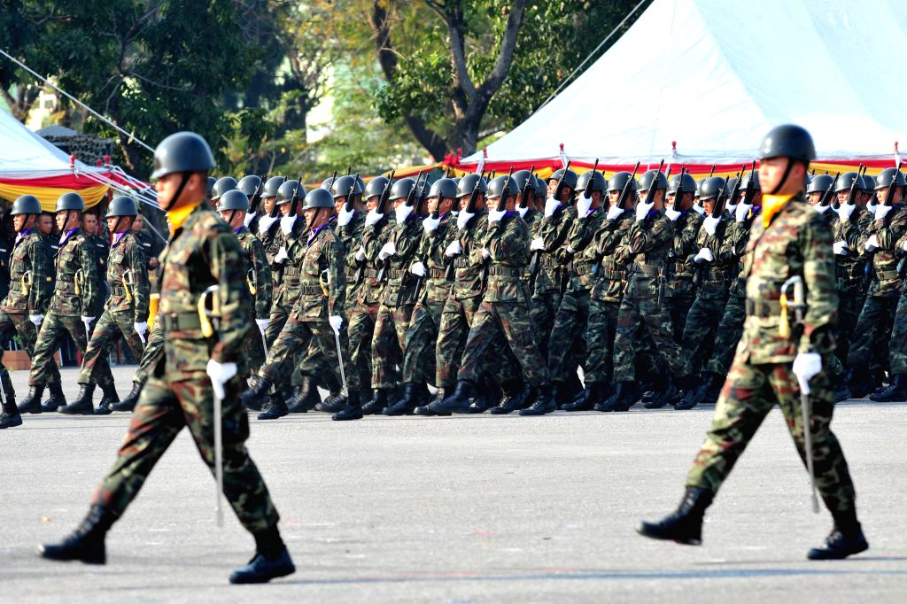 Thai soldiers parade during celebrations of the Royal Thai Armed Forces Day at a military base in Bangkok, Thailand, Jan. 18, 2015. (Xinhua/Rachen ...
