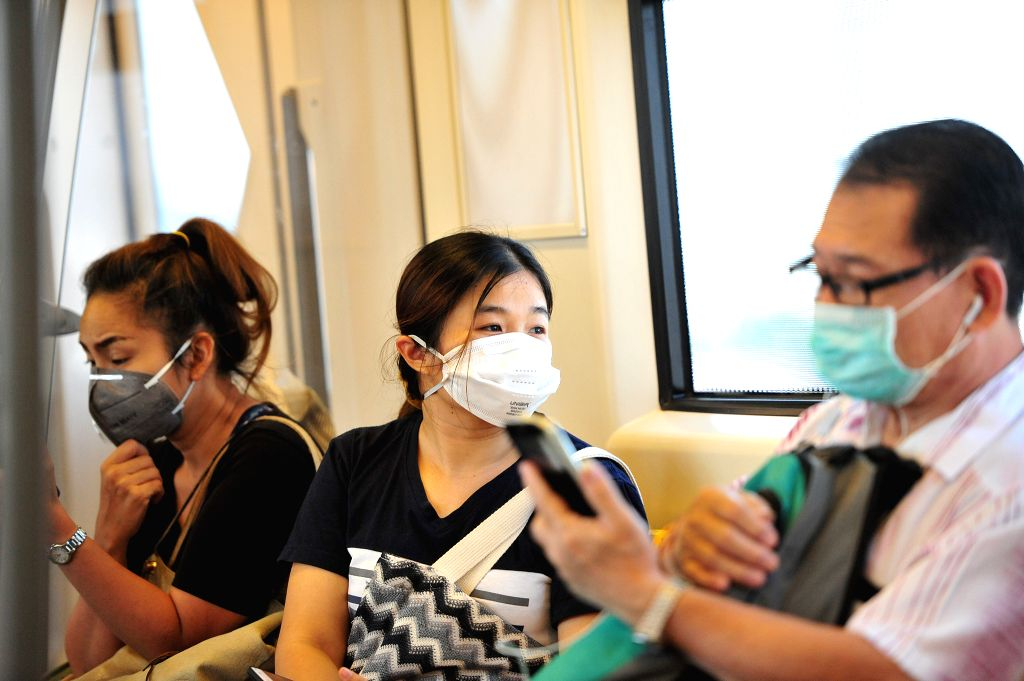BANGKOK, Jan. 29, 2019 - Thai people wearing face masks sit in a public transport vehicle as heavy air pollution continues to affect Bangkok, Thailand,  Jan.  29, 2019. Fine particulate matter ...
