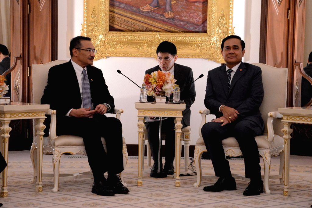 Thai Prime Minister Prayut Chan-o-cha (R) meets with Malaysian Defense Minister Hishammuddin Hussein (L) at the Government House in Bangkok, Thailand, Jan. 30, ... - Prayut Chan