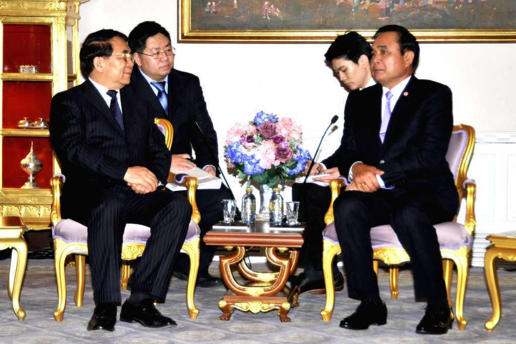 Thai Prime Minister Prayuth Chan-ocha (R front) talks with Bai Chunli (L front), the president of the Chinese Academy of Sciences at Government House in Bangkok, ... - Prayuth Chan