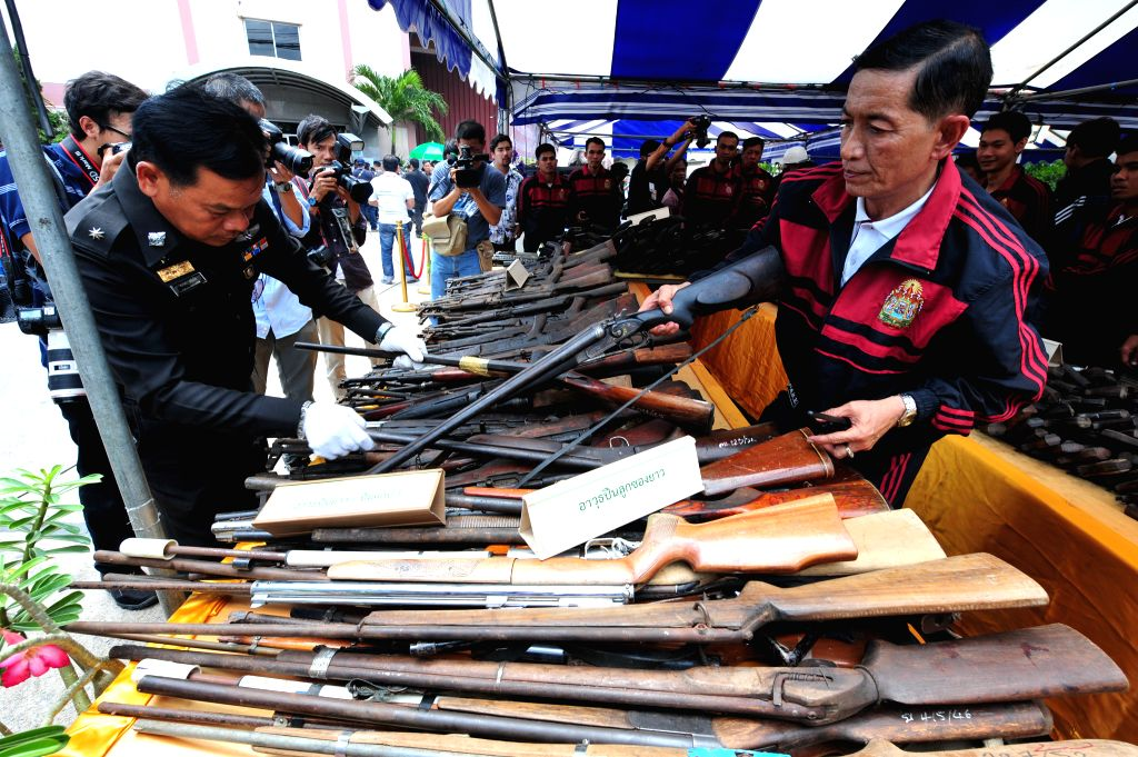 Thai policemen manage seized guns to be destroyed at Ironworks factory near Bangkok, Thailand, July 15, 2014. All together 34,350 guns that were seized by court ...