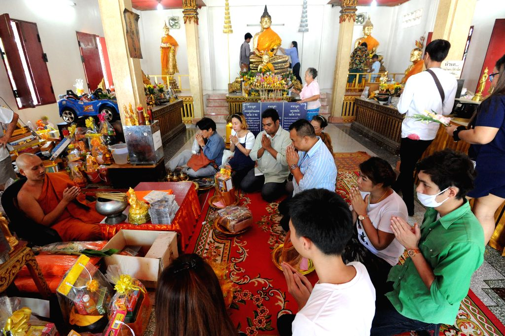 BANGKOK, July 19, 2016 - Thai people make merit and listen to a monk's sermons at a temple in Bangkok, Thailand, July 19, 2016. Thai Buddhists across the country are ready to celebrate the Buddhist ...