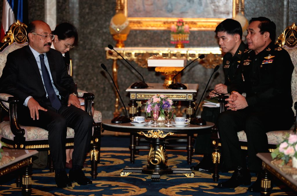 Thai army chief General Prayuth Chan-ocha (R, front) meets with Harsh Vardhan Shringla (L, front), Ambassador of India in Thailand at Thai Army headquarter in ...