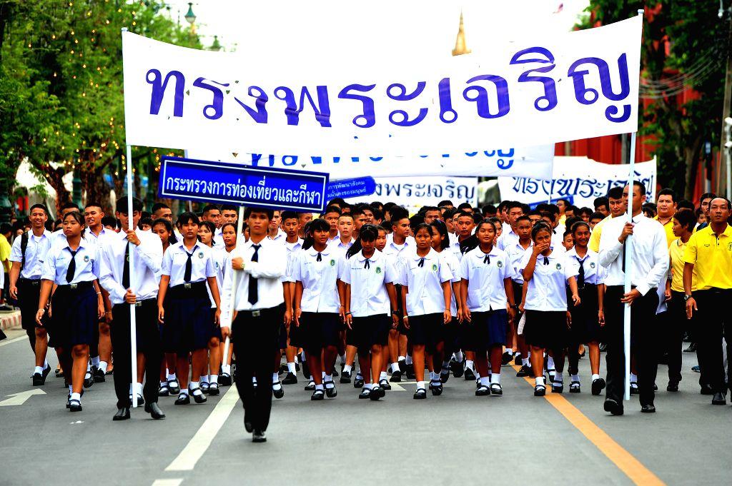 BANGKOK, July 28, 2018 - People parade during the celebration marking Thai King Maha Vajiralongkorn's birthday in Bangkok, Thailand, on July 28, 2018. Thai officials and the general public joined to ...
