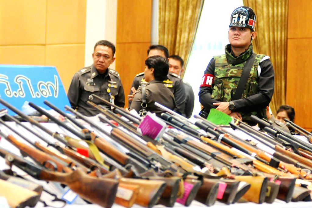 Thai Army officers display 1500 weapons that were confiscated in July in a press conference in Bangkok, Thailand, on July 29, 2014. The military led a crackdown on .