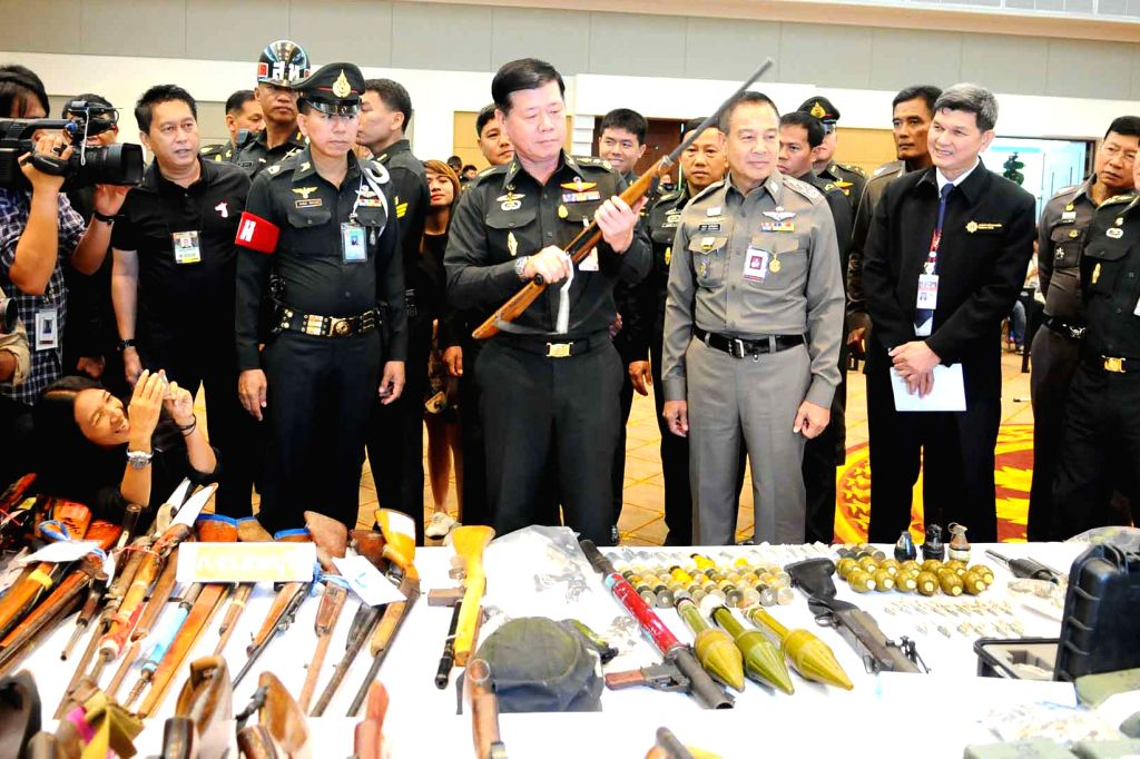 Thai Army officers display 1500 weapons which were confiscated in July, during a press conference in Bangkok, Thailand, on July 29, 2014. The military led a ...