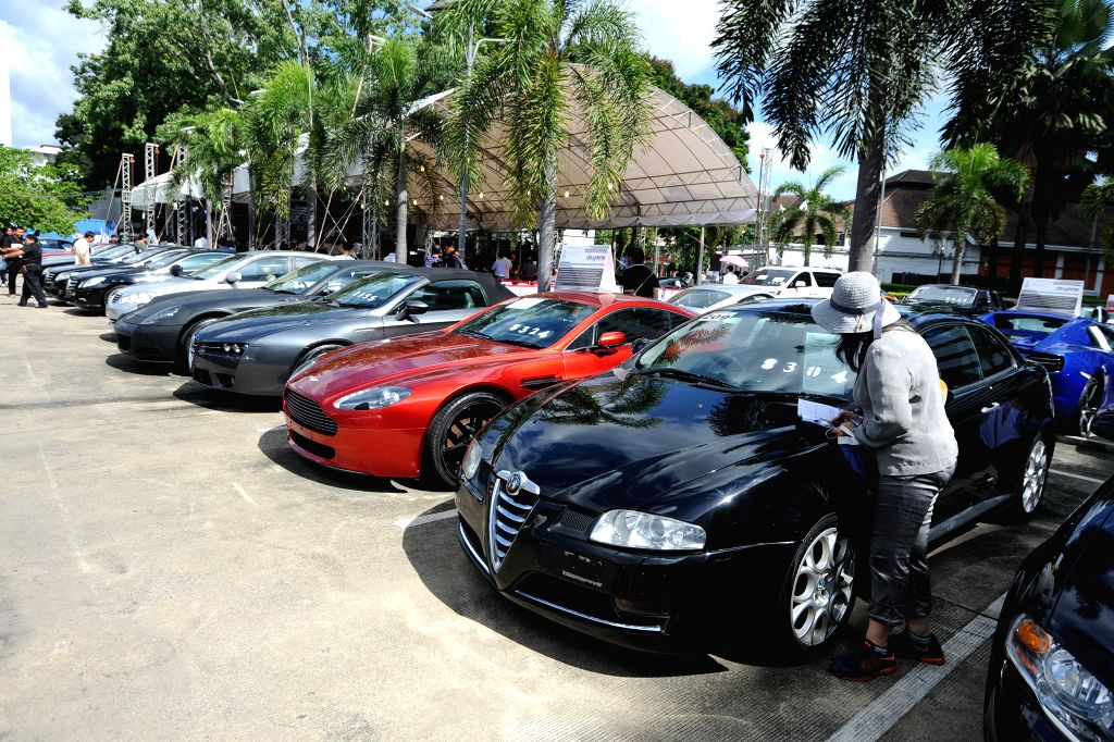 BANGKOK, July 6, 2017 - People attend an auction of seized luxury cars at the Thai Customs Headquarters in Bangkok, Thailand, July 6, 2017. A total of 300 seized luxury cars were auctioned on ...