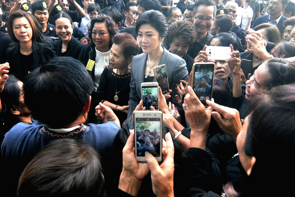 BANGKOK, July 7, 2017 - Former Thai Prime Minister Yingluck Shinawatra (C) is greeted by supporters before attending a hearing on criminal charges stemming from her government's rice pledging scheme ... - Yingluck Shinawatra
