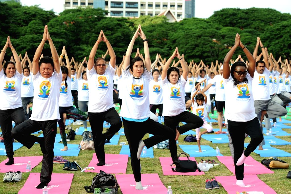 BANGKOK, June 18, 2017 - People practice yoga as they participate in an event to mark the upcoming International Day of Yoga in Bangkok, Thailand, June 18, 2017. On Dec. 11, 2014, the United Nations ...