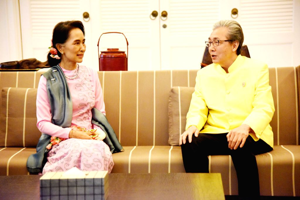 BANGKOK, June 23, 2016 - Myanmar State Counselor and Foreign Minister Aung San Suu Kyi (L) is greeted by Deputy Prime Minister of Thailand Somkid Jatusripitak after her arrival at Suvarnabhumi ... - Aung San Suu Kyi