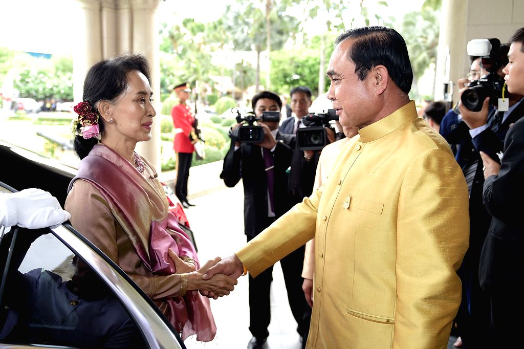 BANGKOK, June 24, 2016 - Thai Prime Minister Prayut Chan-o-cha (R) shakes hands with Myanmar State Counselor and Foreign Minister Aung San Suu Kyi at the Government House in Bangkok, Thailand, June ... - Prayut Chan