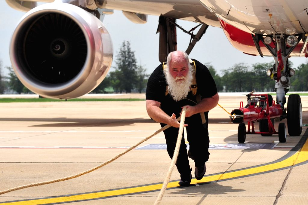 Kevin Fast pulls the Airbus A320-200 weighing 55 tons at Don-Muang Airport in Bangkok, Thailand, June 27, 2014. Kevin Fast, who is recorded as a Superhuman ...
