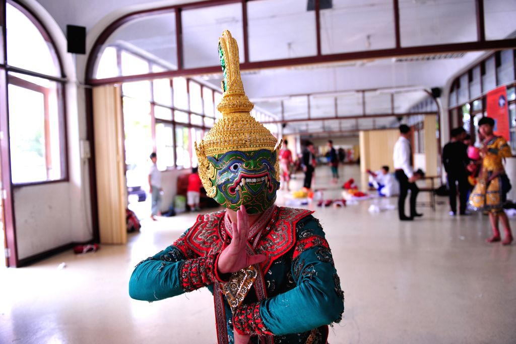 """A Thai student actor poses for a photo as he prepares for a performance of Thai traditional """"Khon"""" in Bangkok, Thailand, March 19, 2015. Students at the ..."""