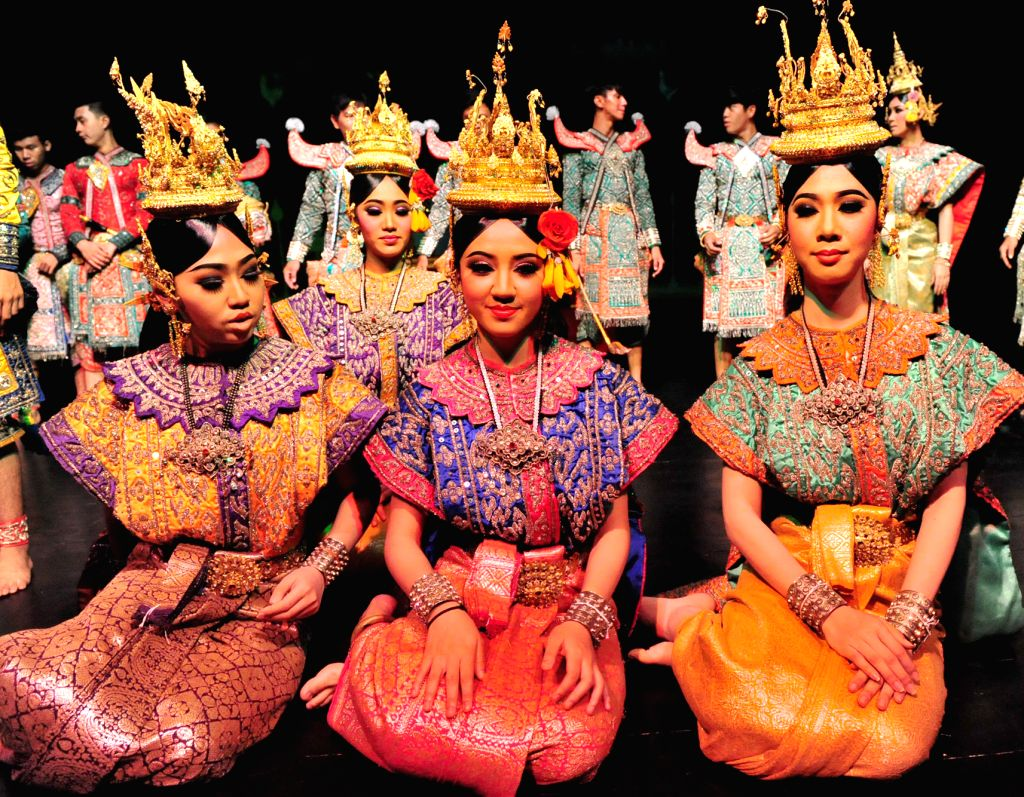 """Thai student actresses pose for a photo as they prepare for a performance of Thai traditional """"Khon"""" in Bangkok, Thailand, March 19, 2015. Students at ..."""