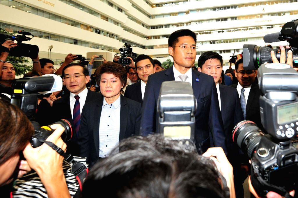BANGKOK, March 7, 2019 - Thai Raksa Chart Party leader Preechapol Pongpanich (R, front) and members of Thai Raksa Chart Party are seen at the Constitutional Court in Bangkok, Thailand, March 7, 2019. ...