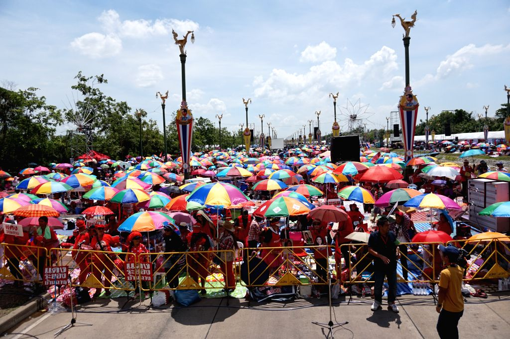 Red-shirt supporters attend a rally on the outskirts of Bangkok, Thailand, May 10, 2014. Supporters of Thailand's beleaguered government gathered on Saturday on the .