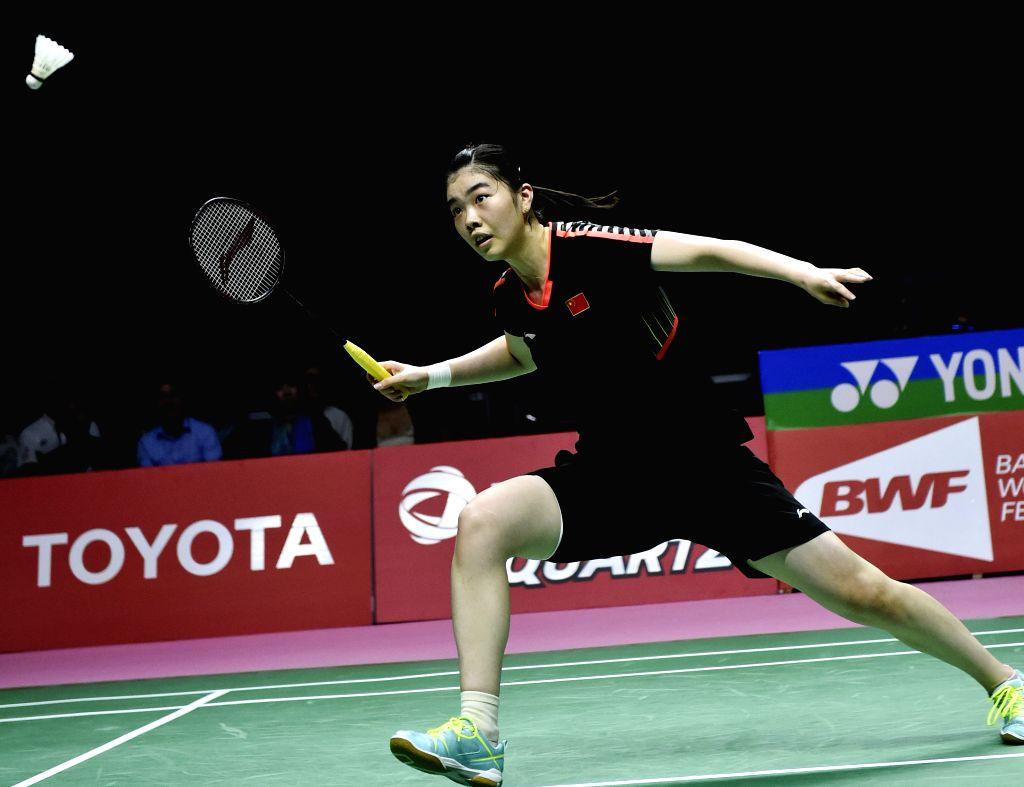 BANGKOK, May 25, 2018 - Gao Fangjie of team China hits a return against Nitchaon Jindapol of team Thailand during the BWF Uber Cup 2018 semifinal in Bangkok, Thailand, on May 25, 2018.