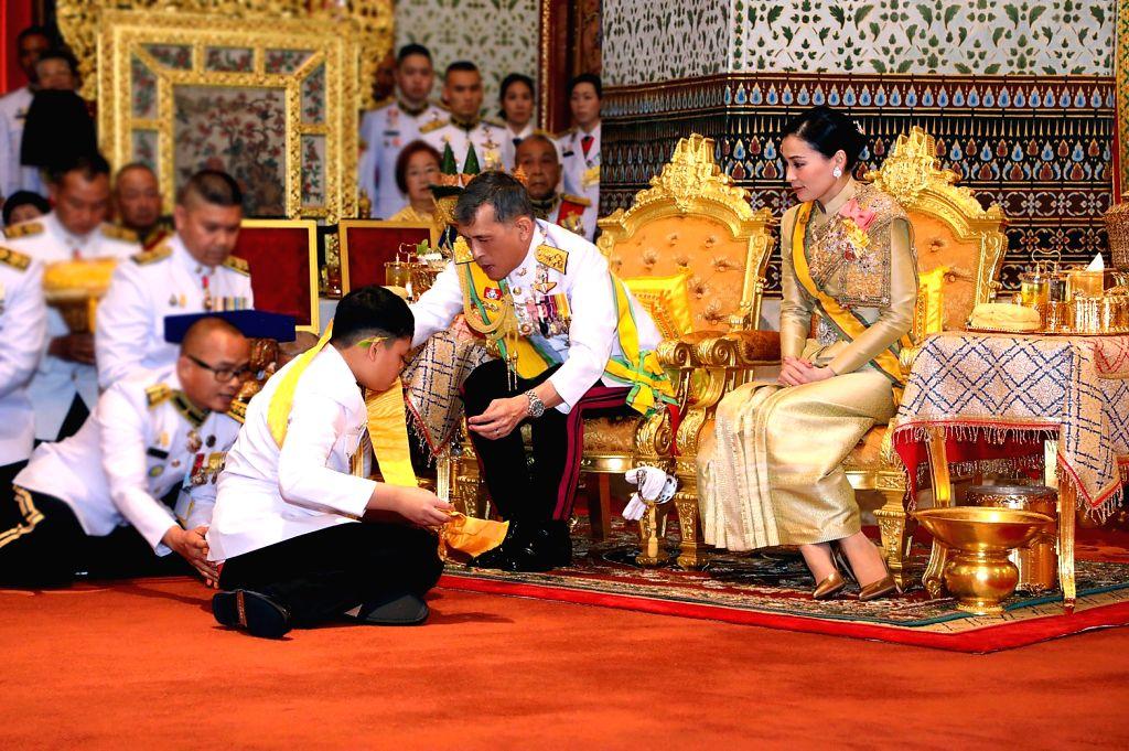 BANGKOK, May 6, 2019 - Thai King Maha Vajiralongkorn grants new title and royal medals to his son Prince Dipangkorn Rasmijoti in Grand Palace, Bangkok, Thailand, on May 5, 2019. Thailand's newly ...
