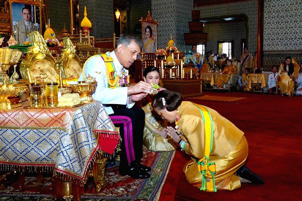 BANGKOK, May 6, 2019 - Thai King Maha Vajiralongkorn pours sacred water on the head of Princess Maha Chakri Sirindhorn to grand new title and royal medals to her in Grand Palace, Bangkok, Thailand on ...