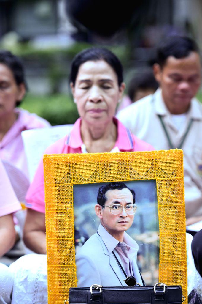 BANGKOK, Oct. 12, 2016 - Thai citizens pray for the health of Thai King Bhumibol Adulyadej at the Siriraj Hospital in Bangkok, Thailand, Oct. 12, 2016. Thai King Bhumibol Adulyadej has remained in ...