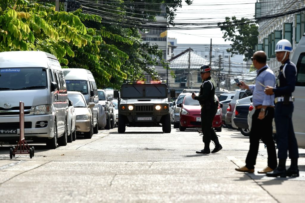 BANGKOK, Sept. 15, 2016 - Military vechiles escort two suspects to a military court in Bangkok, Thailand on Sept. 15, 2016. The court on Thursday held the first hearing on the homicide charges filed ...