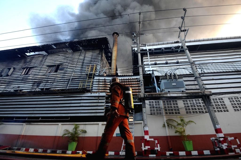 BANGKOK, Sept. 17, 2016 - A firefighter works near a paint factory that caught fire on the outskirts of Bangkok, Thailand, Sept. 17, 2016. No reports of casualties have been reported so far and the ...