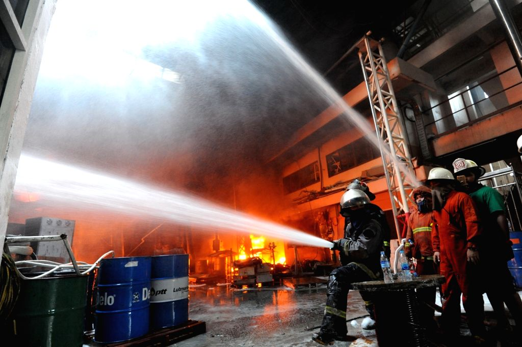 BANGKOK, Sept. 17, 2016 - Firefighters try to extinguish a fire that occured in a paint factory on the outskirts of Bangkok, Thailand, Sept. 17, 2016. No reports of casualties have been reported so ...