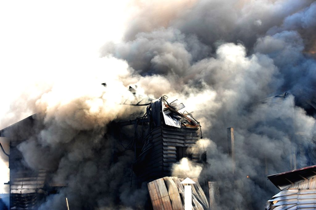 BANGKOK, Sept. 17, 2016 - Photo taken on Sept. 17, 2016 shows smoke rising from a paint factory that caught fire on the outskirts of Bangkok, Thailand, Sept. 17, 2016. No reports of casualties have ...
