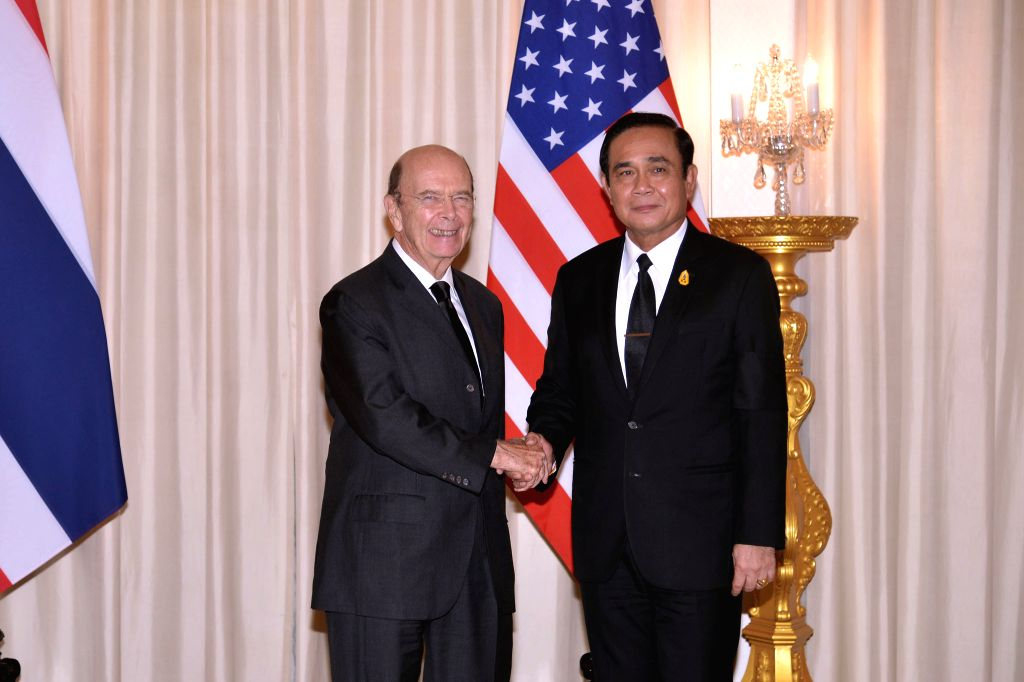 BANGKOK, Sept. 27, 2017 - In this government handout photo taken on Sept. 27, 2017, Thai Prime Minister Prayuth Chan-ocha (R) shakes hands with U.S. Secretary of Commerce Wilbur Ross during their ... - Prayuth Chan