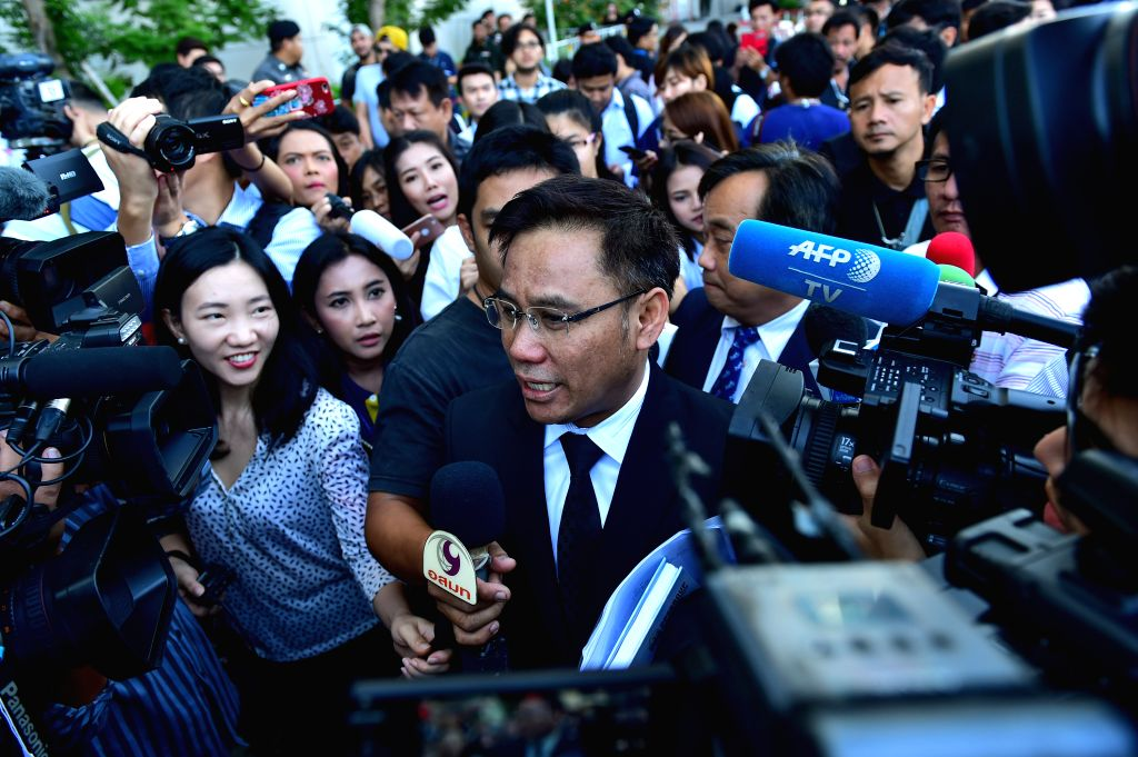 BANGKOK, Sept. 27, 2017 - Norrawit Larlaeng (C), lawyer of former Thai prime minister Yingluck Shinawatra, is interviewed by the press at Thailand's Supreme Court in Bangkok, capital of Thailand on ... - Yingluck Shinawatra