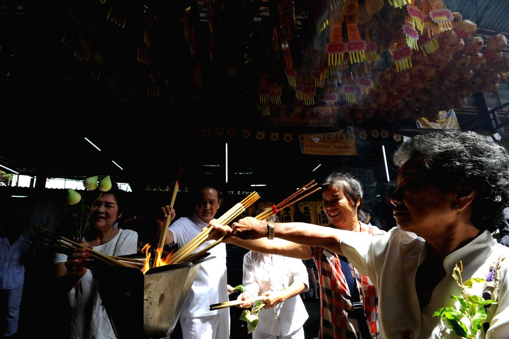 BANGKOK, Sept. 30, 2016 - Worshippers light up joss sticks at a Chinese temple ahead of the Vegetarian Festival in Bangkok, Thailand, Sept. 30, 2016. Thai Chinese will celebrate the 2016 Nine Emperor ...